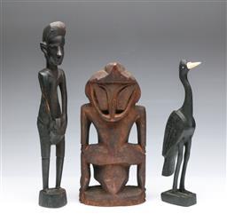Sale 9093P - Lot 51 - Three African Tribal Figures Including Ebony, h. 29-38cm.