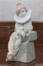 Sale 8375A - Lot 60 - Lladro figure of a boy in a Pierrot costume. Ht 20cm...