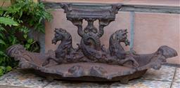 Sale 9120H - Lot 1 - An ornate cast iron boot scrape raised on double hippocampii base, Width 49cm