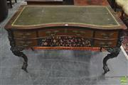 Sale 8335 - Lot 1046 - 19th Century Probably Dutch Rosewood Desk, with serpentine front, tooled leather top & Five drawers, raised on carved cabriole legs