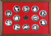 Sale 8935 - Lot 90 - Cased set of 12 Canadian sterling silver coins of The Provinces of Canada