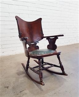 Sale 9126 - Lot 1040 - Late 19th/ Early 20th Century American Childs Rocking Chair, the back with applied carvings, a green leather seat below, raised on...