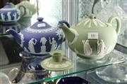 Sale 8322 - Lot 66 - Wedgwood Green Jasper Ware Teapot with a Dark Blue Example (spout damaged)