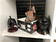 Sale 8819 - Lot 2383 - 2 Miniature Helmets and a Model Boat