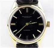 Sale 8402W - Lot 38 - IWC AUTOMATIC WRISTWATCH; ref; 910A with black dial (re painted with some chipping), applied golden markers, centre seconds on a 21...