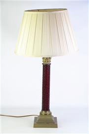 Sale 8876 - Lot 1076 - Ruby Glass & Brass Column Table Lamp, with Corinthian capital and moulded strawberry pattern column & on stepped base