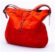 Sale 8921 - Lot 18 - A COACH RED SUEDE DRAWER STRING SHOULDER BAG; with adjustable red leather shoulder strap and drawer string, brass hardware, monogram...