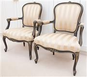 Sale 8990H - Lot 48 - A pair of Louis XIV style satin striped upholstered elbow chairs with carved and painted black frame with gilt detail, Height of bac...