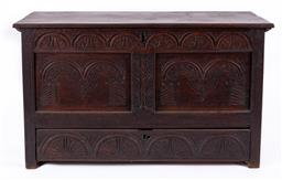 Sale 9190H - Lot 8 - Early Georgian oak coffer, the hinged lid over two carved recessed panels over a single drawer, the interior fitted with a candle bo...