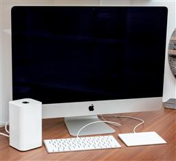 Sale 9150H - Lot 36 - An iMac computer with accessories including keyboard, touch pad and AirPort time capsule