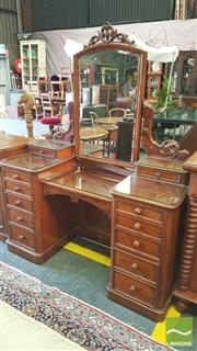 Sale 8402 - Lot 1098 - Victorian Mahogany Pedestal Dressing Table, with carved mirror & supports, twelve graduated drawers & fully enclosed below