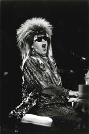 Sale 8665M - Lot 5007 - Elton John, 1987