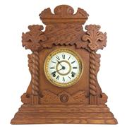 Sale 8795K - Lot 267 - A carved oak mantle clock