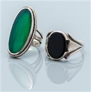 Sale 9037F - Lot 10 - TWO SILVER STONE SET COCKTAIL RINGS; set with an oval green stone, size K, top 31 x 16mm, other with onyx, size W 1/2, top 17 x 11cm...
