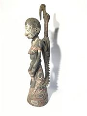 Sale 8706A - Lot 98 - A Papua New Guinea PNG carved statue painted with natural pigments general wear, some small chips on base, H 74cm