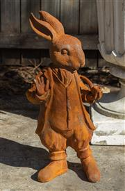 Sale 8745A - Lot 26 - A cast iron Rabbit statue from Alice in Wonderland, H 43cm