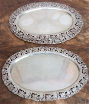 Sale 8650A - Lot 45 - A graduated set of three Austro Hungarian third standard silver trays the pierced border with Art Nouveau floral motifs, marked Vien...