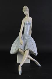 Sale 8840 - Lot 76 - A Large Lladro Figure of a Seated Ballerina