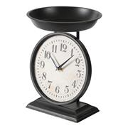 Sale 9075T - Lot 83 - Iron Table Clock with a scale design tray on top in a black finish. H: 34 x W: 25 x D: 25