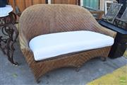 Sale 8390 - Lot 1372 - Wicker Two Seater Patio Sofa with Cushion