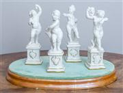 Sale 8650A - Lot 46 - A set of four Hutschenreuther blanc de chine of figure of putti of the seasons and theatre, Height 14cm on an associated stand.