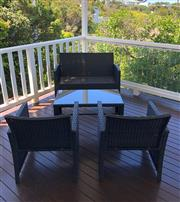 Sale 8858H - Lot 92 - Four Piece Rattan Outdoor Setting including a Two Seater Lounge, 2x Single Seat Lounges and Coffee Table, new, H 77 x W 110 x D 53 c...