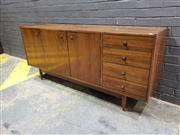 Sale 9022 - Lot 1012 - Chiswell Teak Sideboard with 4 Drawers and 3 Doors (h:75 x w:181 x d:45cm)
