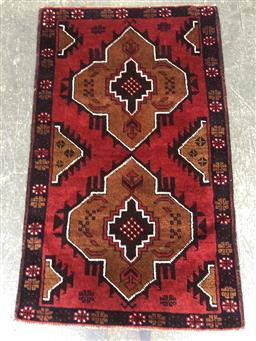 Sale 9112 - Lot 1041 - Hand knotted pure wool Persian Baluchi in red and blue tones (145 x 80cm)