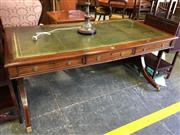 Sale 8666 - Lot 1066 - Regency Style Mahogany Library Table, with tooled green leather top, each side fitted with three drawers, on end supports with brack...