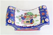 Sale 8977 - Lot 39 - A Chinese Polychrome Porcelain Pillow featuring Ladies (25cm x 13cm)