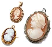 Sale 9046 - Lot 344 - THREE CAMEO PENDANTS; one in 18ct gold with resin cameo, 18mm, wt. 1.6g, a shell cameo in 9ct gold 20mm, wt. 1g, other a shell cameo...