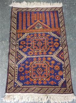 Sale 9129 - Lot 1071 - Probably Turkoman wool prayer carpet in blue, orange & red tones (130 x 75cm)
