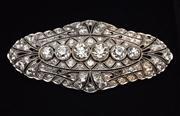 Sale 8590A - Lot 53 - An Art Deco Platinum Diamond Brooch, centring a line of 6 millegrain set  Old Europen cut diamonds totalling an estimated 2.91ct (es...