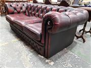 Sale 8792 - Lot 1045A - Burgundy Leather Three Seater Chesterfield, with buttoned back, arms & to the front