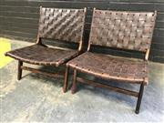 Sale 9056 - Lot 1068 - Pair Of Rosewood Lounge Chairs With Leather Strapping  (H68 x 68 x 78cm)