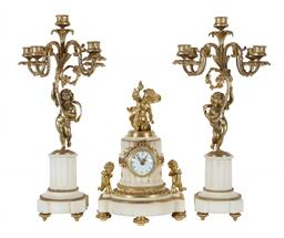 Sale 9245J - Lot 55 - A quality French 19th century three piece Carrara and ormolu clock set, with fluted marble bases and cherub supports, signed Maple &...