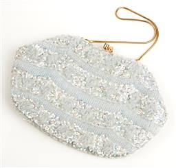 Sale 9091F - Lot 74 - A PALE BLUE SEQUINNED CLUTCH; gold tone snake link concealable handle