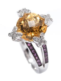 Sale 9199J - Lot 51 - AN 18CT WHITE GOLD CITRINE DIAMOND AND SAPPHIRE DRESS RING; featuring a round chequerboard cut citrine of 5.71ct to round brilliant c..