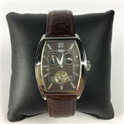 Sale 8292B - Lot 52 - A WOHLER AUTOMATIC WRISTWATCH, with two subsidiary dials and moon phase aperture with reveared escarpment on leather band, new in gi..