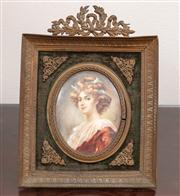 Sale 8804A - Lot 99 - A gilt brass framed miniature of a young woman signed Regicol H 20cm
