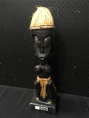 Sale 9051 - Lot 1039 - Carved African Wooden Figure