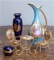 Sale 8650A - Lot 55 - A group of Limoges miniatures including vases, miniature furniture, tallest Height 15.5cm.