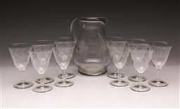 Sale 9107 - Lot 91 - A Glass drinks set of 12 pieces comprising water jug and eleven enamelled stem glasses.