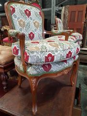 Sale 8814 - Lot 1098 - Pair of Louis XV Style Beech Armchairs, upholstered in cream fabric with red & yellow flowers, raised on cabriole legs
