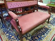 Sale 8792 - Lot 1088 - late Victorian Walnut Settee, the buttoned back with gallery of small panels, upholstered in pink velvet