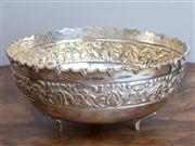 Sale 8650A - Lot 58 - An Indian silver bowl with chased floral band and leaf shaped feet, Diameter 23.5cm.