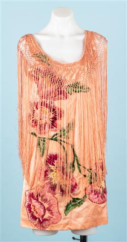Sale 9092F - Lot 85 - A VINTAGE TASSLED FLAPPER DRESS; with floral pattern, Size S (lots of stains commensurate with age)