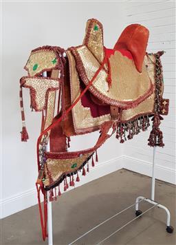 Sale 9190H - Lot 10 - Mongolian saddle with ceremonial decoration, Length 62cm