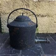 Sale 8795K - Lot 284 - A cast iron boiler with brass tap