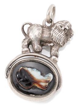 Sale 9145 - Lot 382 - AN ANTIQUE SILVER SPINNING FOB; featuring a lion surmounting an oval spinning fob one side set with a carved layered agate featuring...
